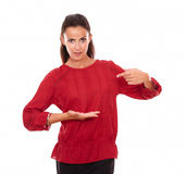 Charming female pointing and holding her palm up Royalty Free Stock Images