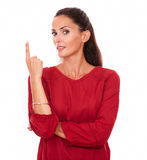 Charming female pointing up her finger Stock Image