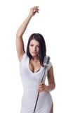 Charming female singer posing at camera Royalty Free Stock Images