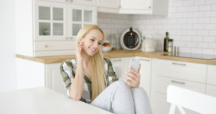 Charming female taking selfie in kitchen Royalty Free Stock Images