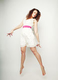 Charming female in white dress jumping Stock Photos