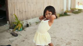 MANILA, PHILIPPINES - JANUARY 5, 2018: A charming Filipino little girl in a white dress cute and fun posing on the stock video