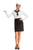 Charming flight stewardess showing various gesture Royalty Free Stock Photo