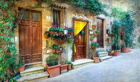 Charming floral decorated streets of medieval towns of Italy. Pi Royalty Free Stock Image