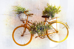 Charming floral street decoration with old bike. Retro picture Royalty Free Stock Photo