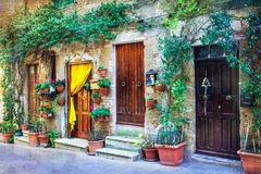 Charming floral streets of medieval towns of Italy. Pitigliano, Royalty Free Stock Photo