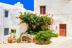 Charming floral streets of old town in Naxos island. Greece. Old streets of Greece,view with doors and floral decoration,Naxos Royalty Free Stock Photo