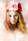 Charming flower. Spring, beautiful, charming woman in white bra and flowers on her head, she has got long, curly hair and natural make up Stock Image