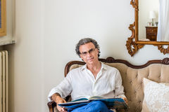 Charming forties with glasses in living room Royalty Free Stock Photo