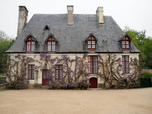 Charming French Cottage Covered in Wisteria Royalty Free Stock Image