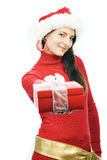 Charming friendly brunette with a Christmas gift Stock Photos