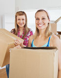 Charming friends holding boxes Royalty Free Stock Photo