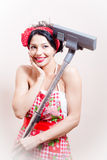 Charming funny young cute pretty woman pinup girl standing with vacuum cleaner and gently smiling on white Royalty Free Stock Photography