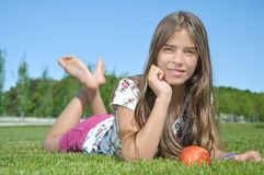 Charming girl with apple Stock Image