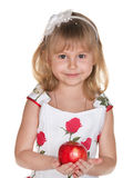 Charming girl with apple Royalty Free Stock Image