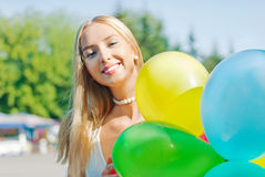 Charming girl with balloons Royalty Free Stock Photography