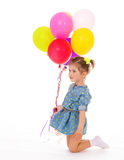 Charming girl with balloons. Stock Photography