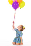 Charming girl with balloons. Stock Image