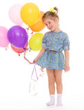 Charming girl with balloons. Royalty Free Stock Photo