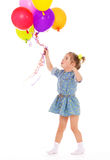 Charming girl with balloons. Stock Photos