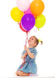 Charming girl with balloons. Royalty Free Stock Photography