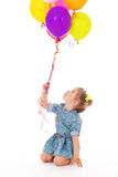 Charming girl with balloons. Royalty Free Stock Photos