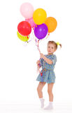 Charming girl with balloons. Royalty Free Stock Image