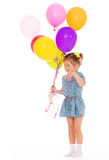 Charming girl with balloons. Stock Images