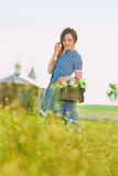 Charming girl with a basket of flowers at the church Stock Photos