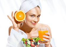 Charming girl after bath enjoying a healthy food. royalty free stock image
