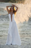 Charming girl on the beach in clothes Royalty Free Stock Images