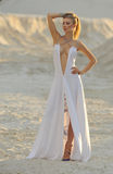 Charming girl on the beach in clothes Stock Images