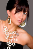 Charming girl with beautiful jewelry. Retouched Stock Photography