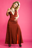 Charming girl in beautiful long red dress Stock Photos