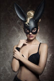 Charming girl with bizarre bunny mask Stock Photography