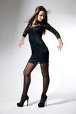 Charming girl in black dress dancing Stock Image