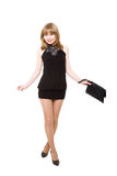 Charming girl in a black short dress Royalty Free Stock Photos
