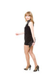 Charming girl in a black short dress Royalty Free Stock Image
