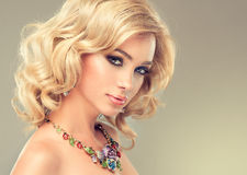 Charming girl blonde curly hair Royalty Free Stock Photos