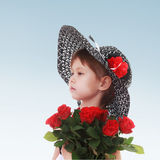 Charming girl with a bouquet of red roses portrait Stock Photography