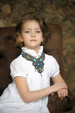 Charming Girl Child In A White Blouse With A Beautiful Necklace Stock Image