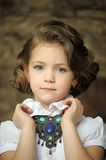 Charming Girl Child In A White Blouse With A Beautiful Necklace Royalty Free Stock Photography