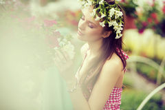 Charming girl with the flower hat Royalty Free Stock Images