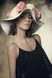 Charming girl with flowers hat Royalty Free Stock Photography