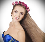 Charming girl with flowers on her head Stock Photo