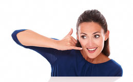 Charming girl gesturing a phone call Royalty Free Stock Photography