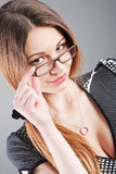 The charming girl in glasses Stock Photos