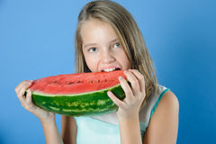 Charming girl has a juicy ripe watermelon. Royalty Free Stock Photo