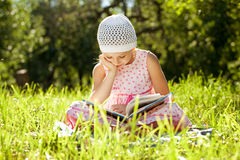 Charming girl in the hat reading a book Stock Photo