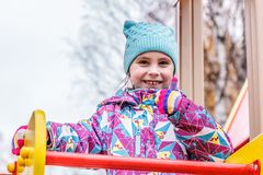 The girl is playing fun on the playground. Royalty Free Stock Photography